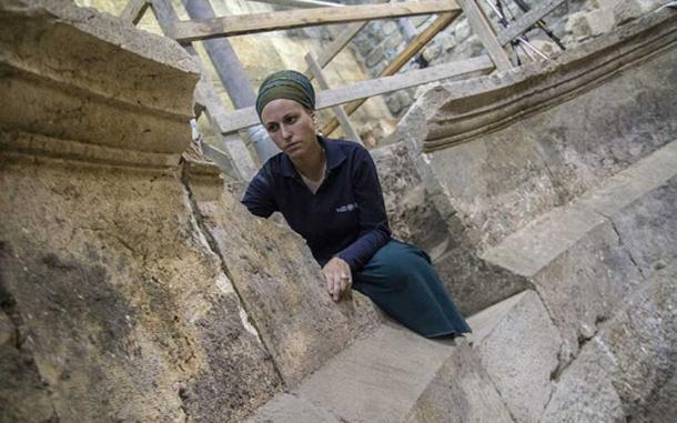 Archaeologist Tehillah Lieberman on unfinished steps (Image: Israel Antiquities)