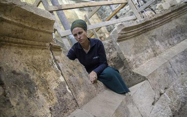 Archaeologist Tehillah Lieberman on unfinished steps (Image: Israel Antiquities)