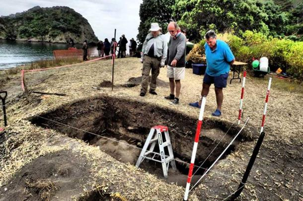 Archaeologists John Coster and Dave Veart, along with local volunteer Jack Kemp, examine the re-opened excavation unit from 1981.