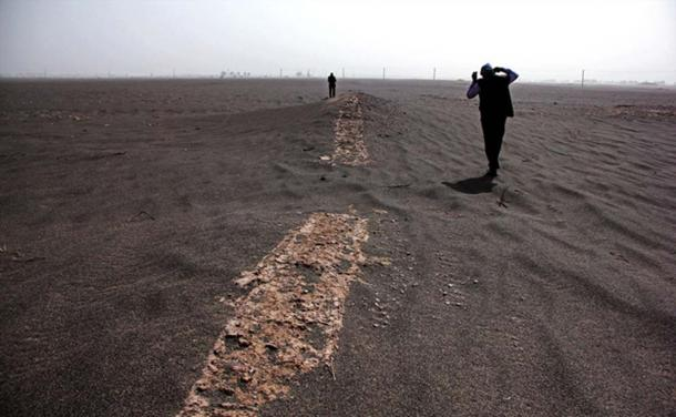 Archaeologists are examining a possible historic site in an arid area of Iran that was exposed by sandstorms in late March. The team is doing surveys, excavating structures and examining earthenware vessels.