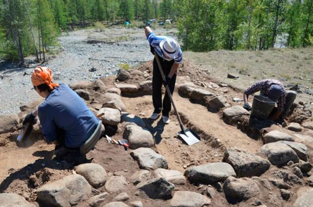 Archaeologists excavating the site where the infant's remains were found.