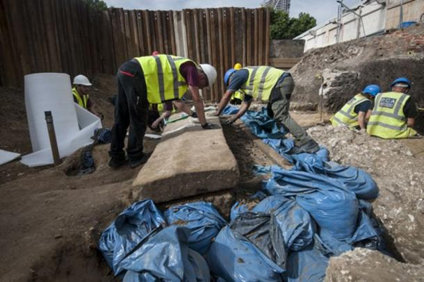 Archaeologists prepare to lift the lid at the site in Swan Street, Southwark