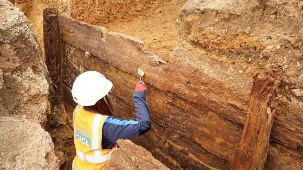 Archaeologists have discovered what they believe to be the long-lost Red Lion Theater, uncovering a rectangular timber structure with 144 surviving timbers. (Archaeology South-East / UCL)