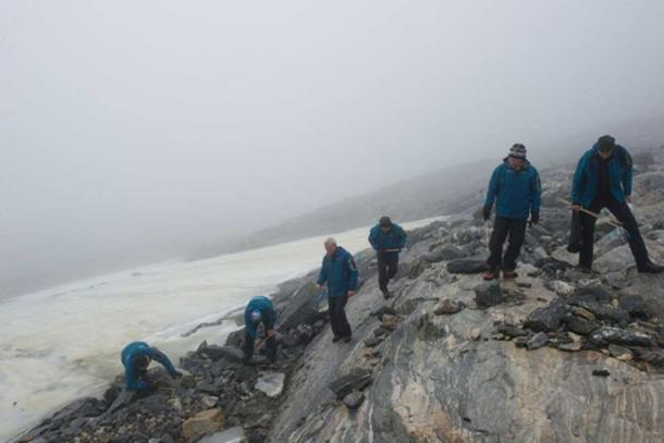 Archaeologists searching for artifacts near a receding glacier in 2011.
