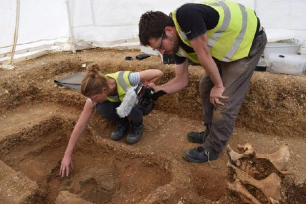 Archaeologists unearthing the warrior shield together with the remains of the man (MAP Archaeological Practice Limited)