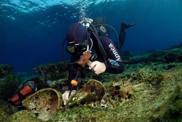Archaeologist extracting an artifact from the Kasos Roman shipwreck – as carefully as is possible
