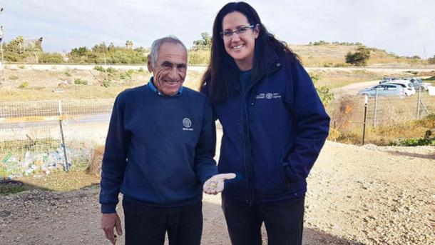 Archaeologists Liat Nadav-Ziv and Marc Molkondov, finder of the gold coins, with the 8th century Chanukah gelt. (Amihai Tamir / Israel Antiquities Authority)