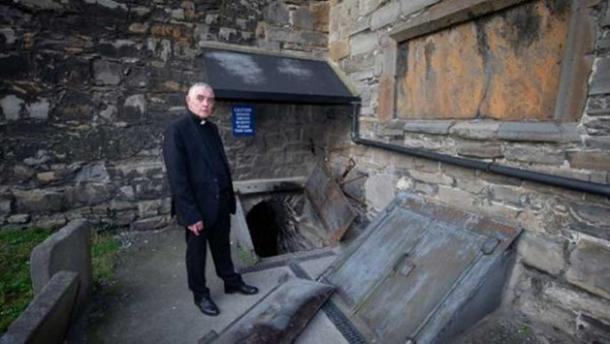 Archdeacon Pierpoint at the crypt at St. Michan's Church. (Tom Honan)