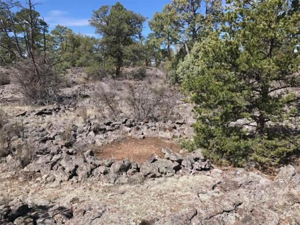 Archeological site next to the cave where it is believed the Ancestral Puebloans left circle-shaped stones while out hunting, which they may have used for ceremonial purposes. (University of South Florida)