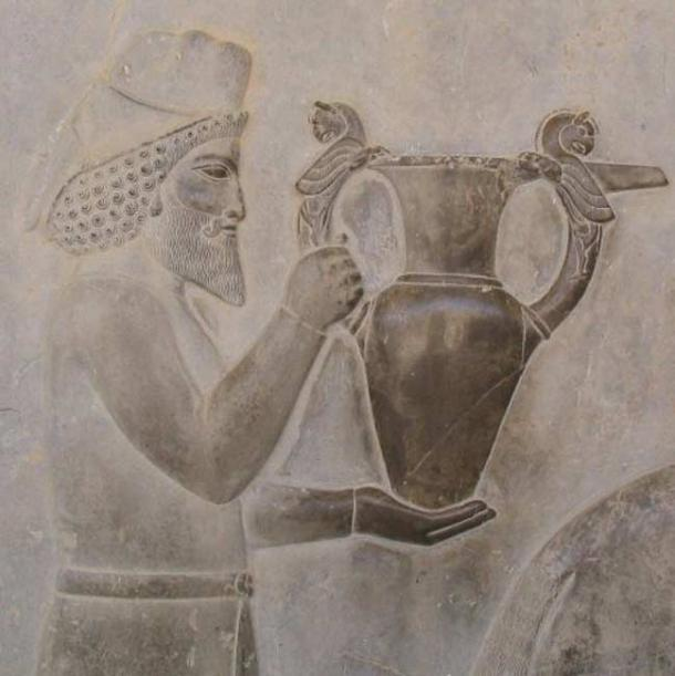 An Armenian tribute bearer carrying a metal vessel with griffin handles. 5th century BC.