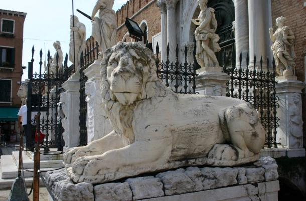 The first lion standing at the right side of the monumental entrance of the Arsenale in Venice.