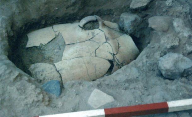 Ashkelon infant burial jar in situ. (B. Doak)