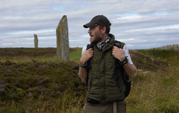 Ashley Cowie at The Ring of Brodgar Neolithic henge and stone circle located about 6 miles (9.6 kilometers) north-east of Stromness on the Mainland, the largest island in Orkney, Scotland. This stone temple is part of the UNESCO World Heritage Site known as the Heart of Neolithic Orkney. (Image: Ashley Cowie)
