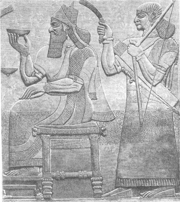 Ashurnasirpal II sitting on a throne.