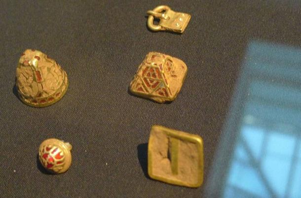 Assorted uncleaned gold fittings, three with cloisonné gold and garnet.