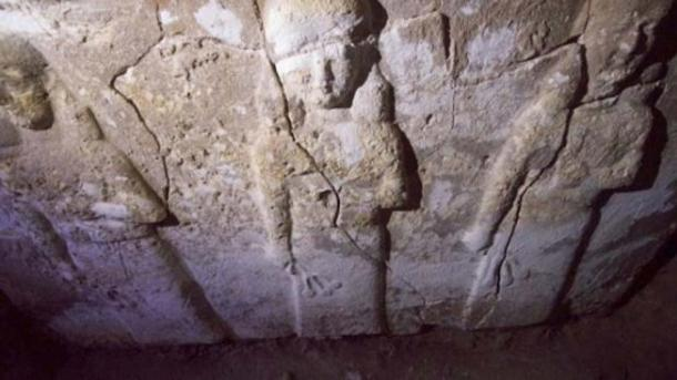 """An Assyrian stone sculpture of a demi-goddess found at the site. She is depicted sprinkling the """"water of life"""" to protect humans."""