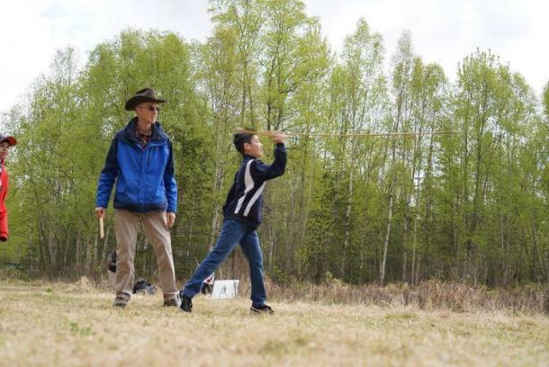 Atlatl spear throwing. A sixth-grader from the Anchorage-area learning to use an atlatl at Campbell Creek Science Center under the supervision of archaeologist Robert King. (Gleason the Bureau of Land Management in Alaska/ CC BY 2.0)