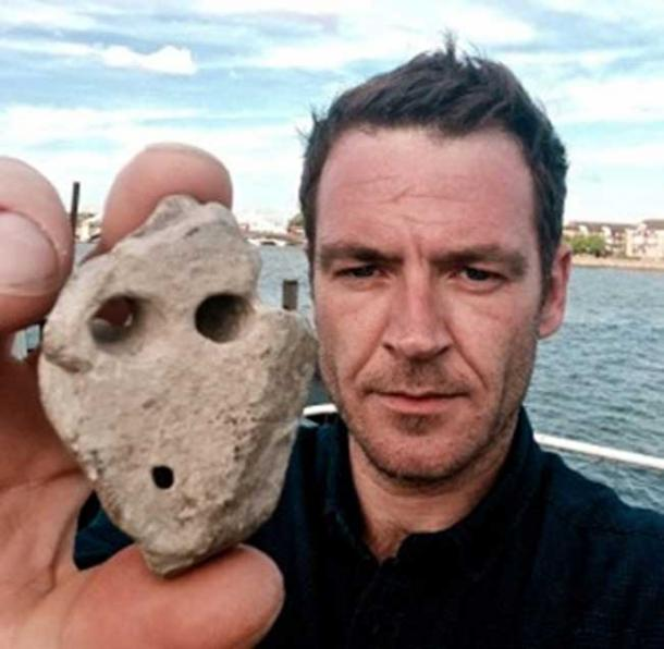 Author Ashley Cowie with the artifact recovered from Murdo's grave.