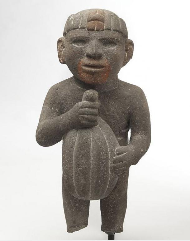 Aztec. Man Carrying a Cacao Pod, 1440–1521. Volcanic stone, traces of red pigment.