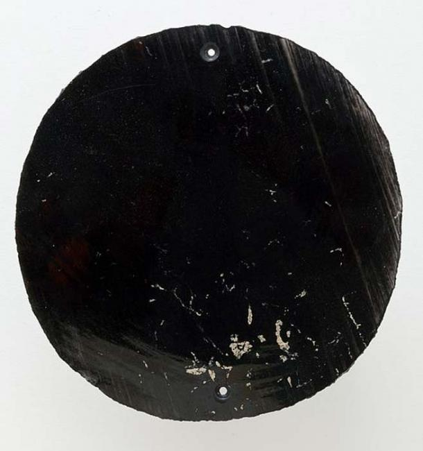 An Aztec mirror made of obsidian.