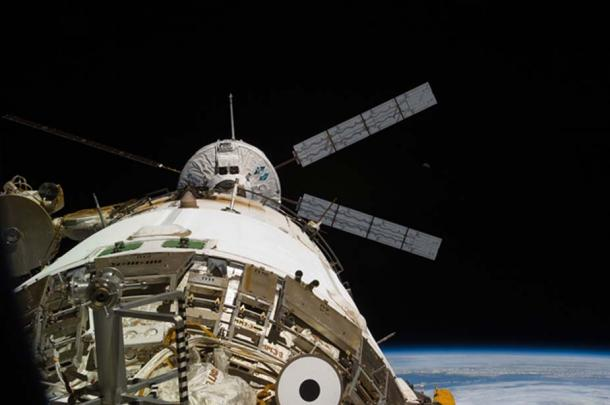 """Back dropped by the blackness of space and Earth's horizon, the European Space Agency's """"Johannes Kepler"""" Automated Transfer Vehicle-2 (ATV-2) docks to the aft end of the International Space Station's Zvezda Service Module"""