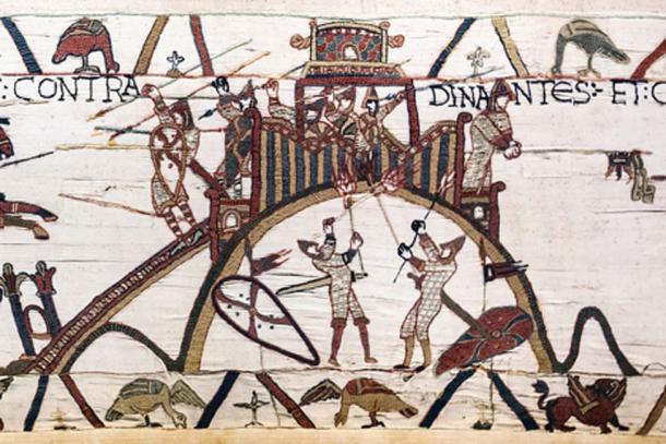 Bayeux Tapestry - Scene 19: siege of Dinan (detail). The soldiers of William, Duke of Normandy attack the motte-and-bailey castle of Dinan. Conan II, Duke of Brittany surrenders and gives the keys to Dinan via a lance. (Public Domain)