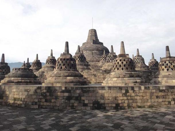 Beautiful Borobudur Temple: Buddha statues in their own latticed domes