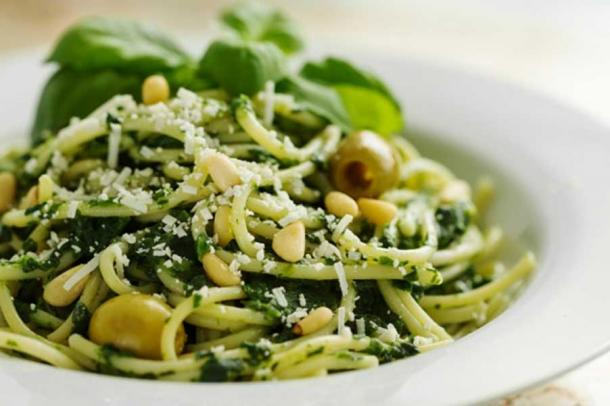 Beautiful Pasta Closeup with Spinach, Cheese, Olives, Basil and Nuts.