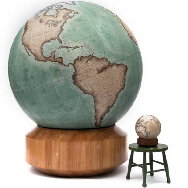 Bellerby & Co.'s largest globe, the 127 cm (50-inch) Churchill, next to its smallest, a 23 cm (9-inch) mini desk globe.