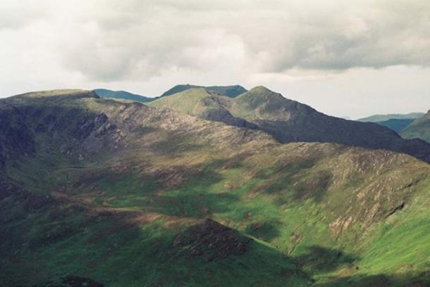 Ben Gorm Mountain (Binn Ghorm) is on the left, at the summit of the long ridge, with the twin tops of Ben Creggan (Binn an Charragain) in the centre