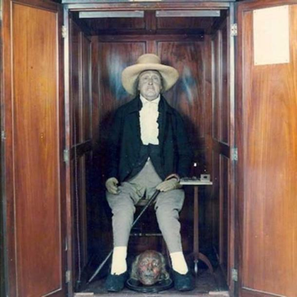 Bentham's 'Auto-Icon' plus mummified head (now in a safe) in the South Cloisters of University College London. (Image: UCL)