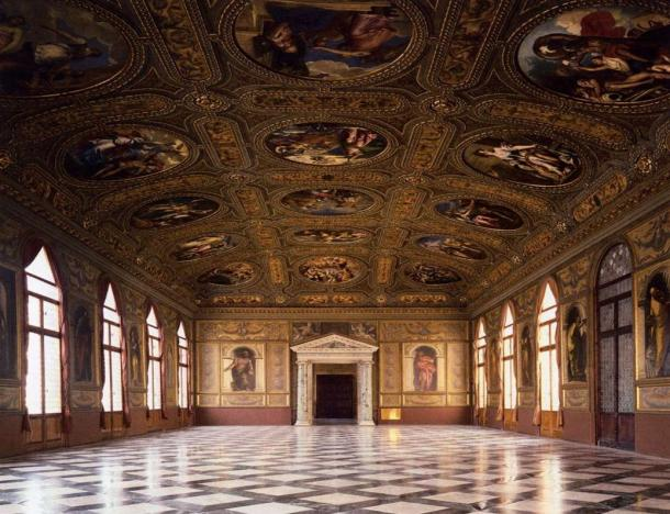 Photograph taken inside the Biblioteca Nazionale Marciana, the ornate ceilings, walls and marbled floors resemble the grandeur of the time when it was built, the artwork and intricate details are astounding.