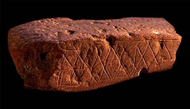 Blombos Cave geometric engravings on ochre estimated at 70,000 years old.