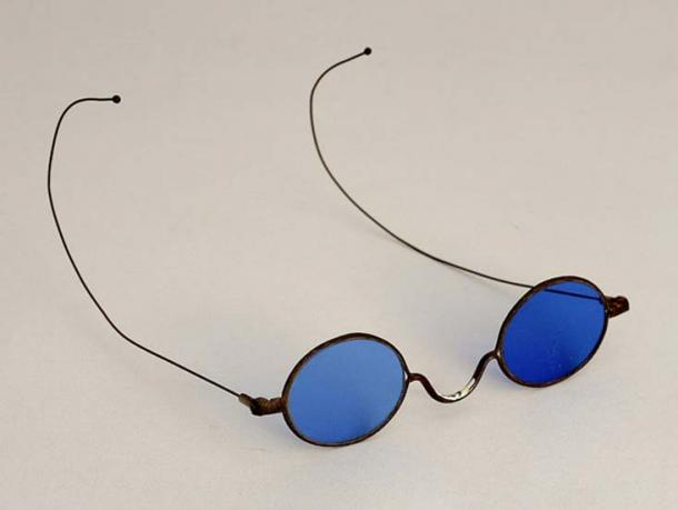 Blue-tinted lenses with a metal wire frame.