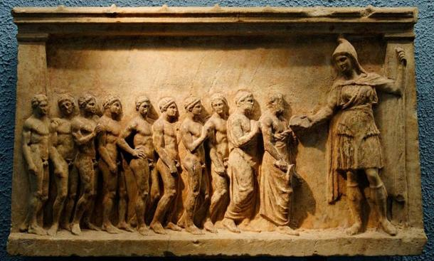 Bnedis-Artemis (on the right, wearing a Phrygian cap, a short tunic, high boots and an animal skin) and her followers, maybe athletes taking part in the torch relay race in honor of the goddess. Marble votive relief, made in Athens, ca. 400-375 BC.