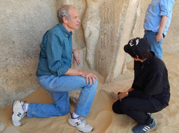 Bob Brier examining carvings in Egypt. Photo credit: Sharon Janet Hague