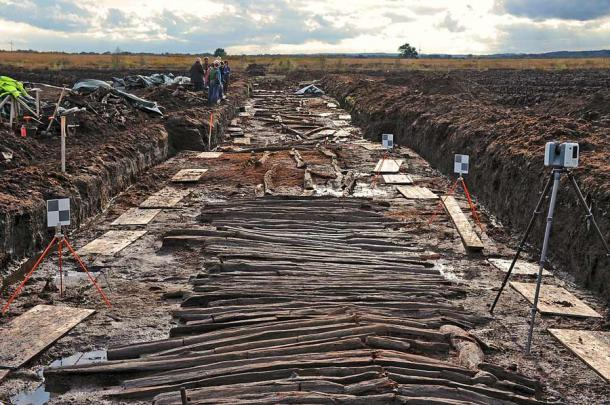 Known as the Bohlenweg Pr 6, this ancient bog path is currently being excavated as part of a project which concludes in 2022. Next to this path archaeologists found the remains of a 2,000-year-old shoe. (Bernard Warnking / CC BY-SA 3.0)