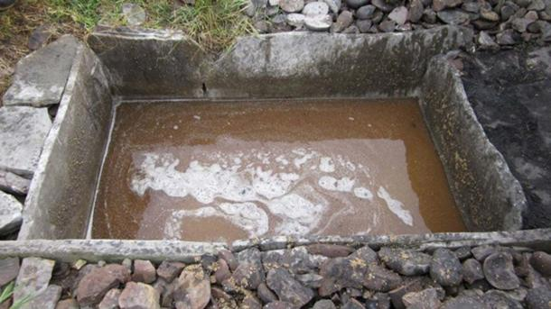 Bressay Heritage Centre, Shetland. Reconstructed burnt mound trough used as a mash tun to make a brew.