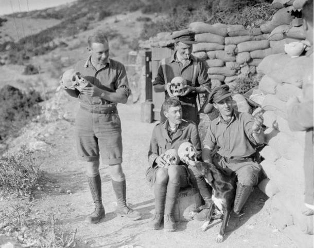 Many tombs and archaeological sites have been disturbed and damaged in order to sell relics to museums. British soldiers with skulls excavated at the ancient Greek site of Amphipolis, 1916.