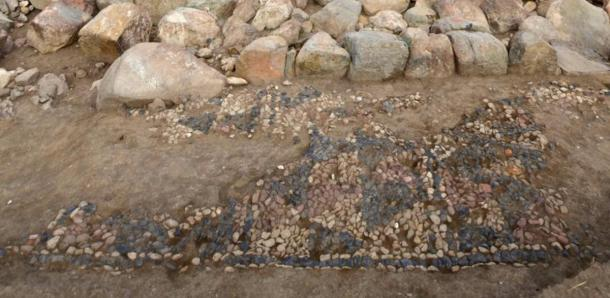 The stone Bronze Age mosaic floor is in the foreground.  (Anacleto D'Agostino / Usa̧klı Höyük Archaeological Project)