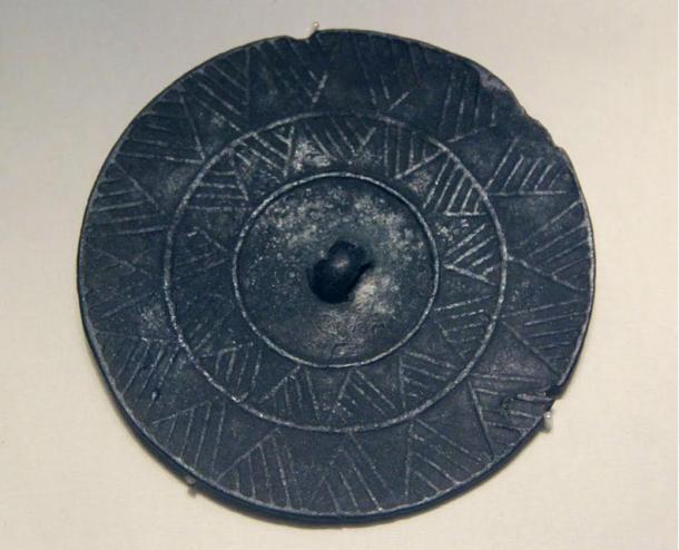 Bronze mirror, Gansu. Qijia culture (2400 - 1900) National Museum of China, Beijing. Phot by Prof. Gary Lee Todd. 2012.