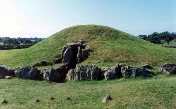 """Bryn Celli Ddu. """"The Mound in a Dark Grove"""". Originally a Neolithic burial chamber, later a passage grave. This tomb could be entered back in 1991 and contained a cast of a spiral carved stone to the rear."""