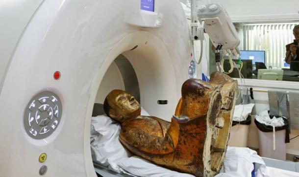 Buddha statue undergoing a CT-Scan.