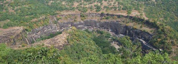Another Buddhist cave site in India is the Ajanta Caves, seen here from across a nearby river.