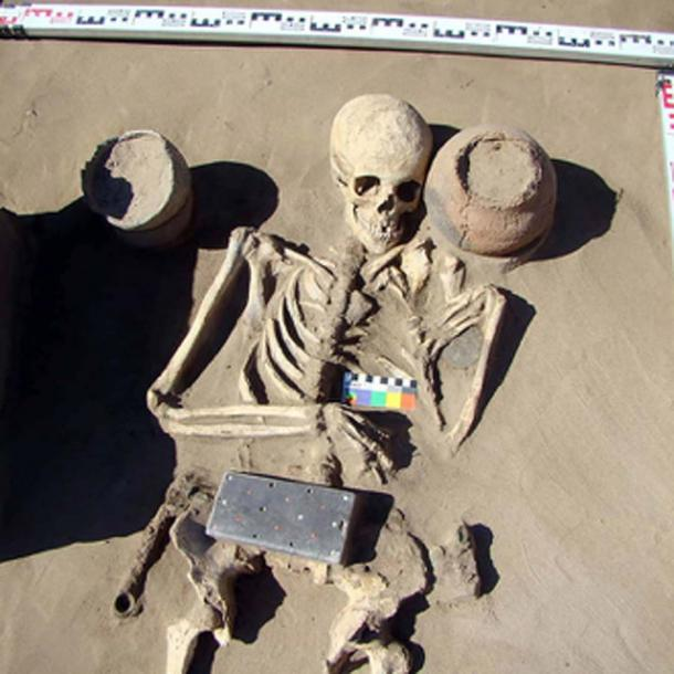 Burial AT 1/29, a 2,100-year-old skeleton with belt buckle. Pictures: HMC RAS/Pavel Leus