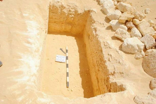 Burial hole and sarcophagus of a child (Photo: Nevine El-Aref)