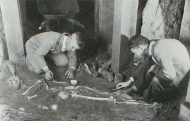Burial in Spearhead Mound including a white chalky substance. Walker is on the left. (James L. Murphy)