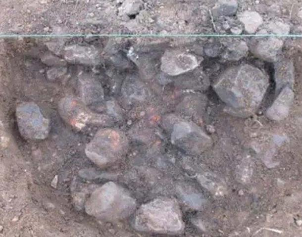 Burnt stones were uncovered in a pit at the center of the henge.