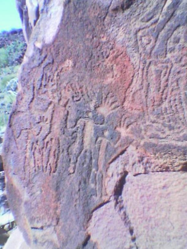 Burrup rock art depicting people with big hands