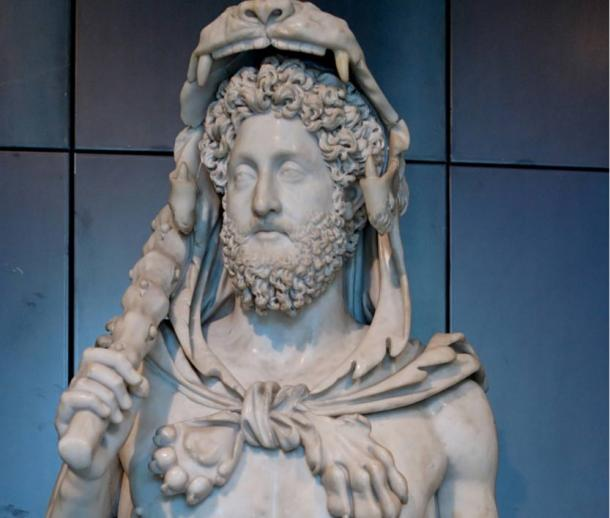 Bust of Commodus as Hercules, hence the lion skin, the club.